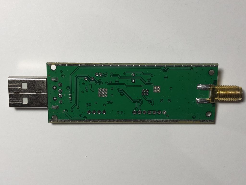 The back side of the PCB, showing extensive thermal via placement
