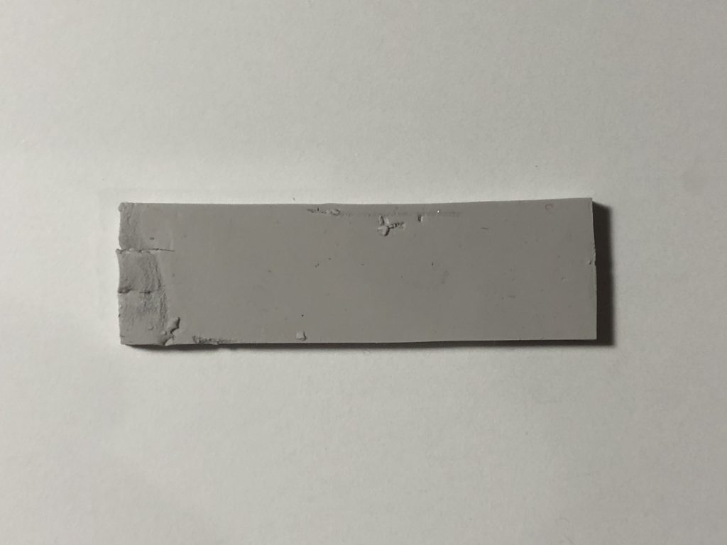 A gigantic gray thermal pad found between the PCB and housing