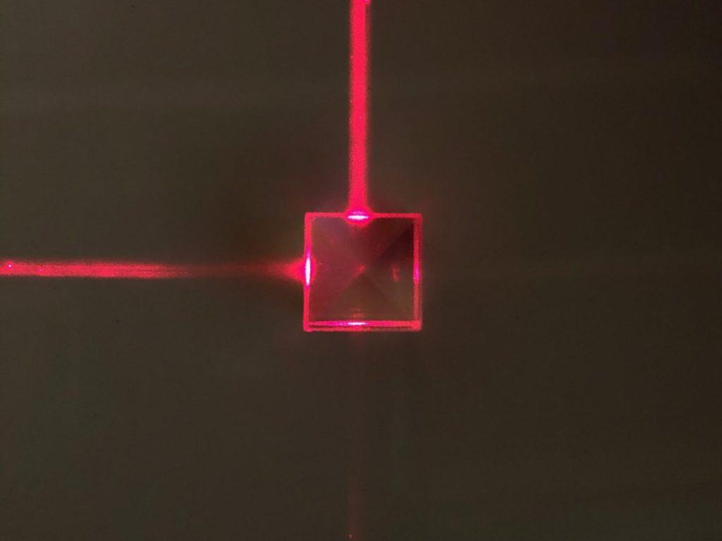 A laser shining through a dichroic cube.