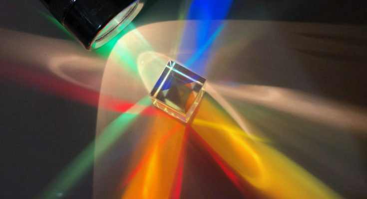 A dichroic cube illuminated by a flashlight.