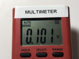 Multimeter showing 0.101 V