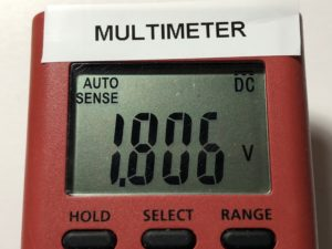 Multimeter showing 1.806 V
